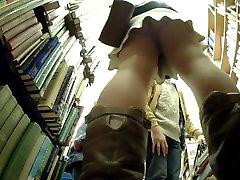 Cutie in Nude Pantyhose Upskirted in bookshop