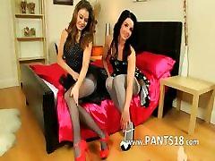 Two brunette lesbs teasing in nylons