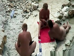 Nudist couple playing cards