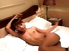 Cute femboy strips down before sucking her lips on huge cock