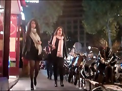 Brunette in mini skirt tights and high grande duela louboutins