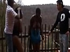African girls get tied to fence and abused by some crazy dudes