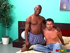 Black guy licking and fingering a white dude