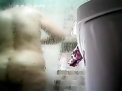 Mature plump Mom takes a shower! Amateur hidden cam!
