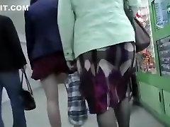 Girl in red miniskirt upskirted