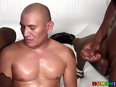 Black poja sax sharing a bald dude