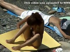 Nudist girl does yoga on the beach