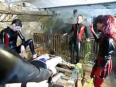 Three hot dominas tie up a slave