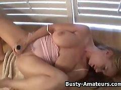 Busty amateur Violet masturbates her shave pussy