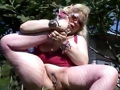 fat mature in fishnets masturbates outdoors