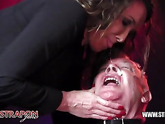 Femdoms latex dominate tag team sissy face fuck strapon