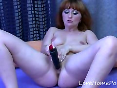 Redhead gian titts drills her pussy with a dildo