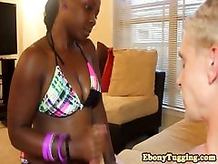 Thick ebony babe in bikini jerking white cock