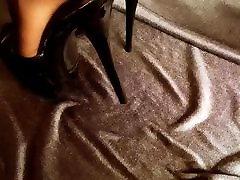 Feet in Nylons and john spenelli heels