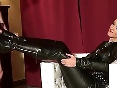 Lady with long oily overloaded sex boots and cumshot