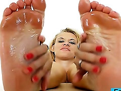 Awesome blonde gives footjobs to vibrator