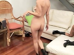 Lesbian babes have fun with a strapon