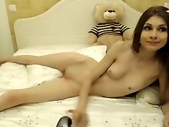 Petite chick spreads her naked body across the bed and touc