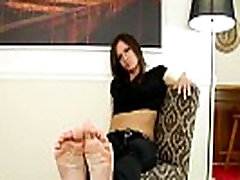 Pedicured shemale teases us with her toes