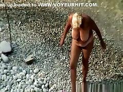Mature nudist blonde woman
