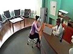 Seductive doctor widens her legs