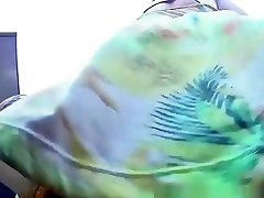Woman in colorful dress butt upskirt