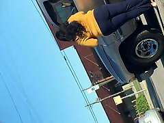 Candid Light Skin sit on her back Standing Outside