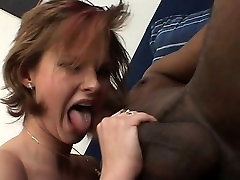 Redhead milf sucks rides a big black cock interracial