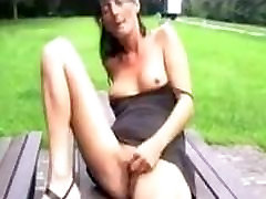 ai nashi full woman masturbates outdoors on resting air