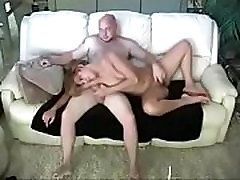 Wife getting amateur milking table on the sofa