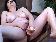Chubby mature skank slams her bath room rep moms vag with a dildo