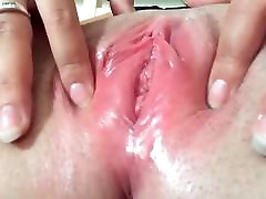 Close up shaved wet pussy