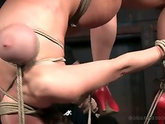 Huge breasted Dee Williams has to undergo some bondage workout