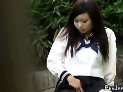 Asian woman fat piss rubs and pees
