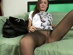 Teen babe on the couch tease in black pantyhose.mp4
