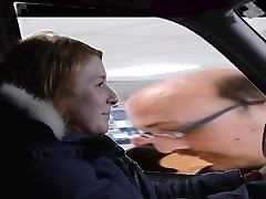 Female driver enjoys man flashing outside of car