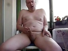 Mature balcony rub and cum