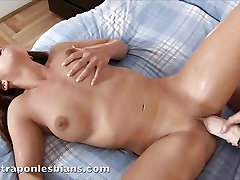Lepidoptera fucks her hot friend hard with huge strapon