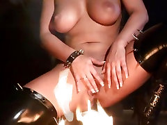 Big tit babe Dorothy Black loves to play with her pussy and with fire