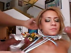 Slutty hot babe Trina Michaels slurps two man meats with a mask