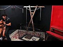 Caged ebony slave Harmonys candle wax punishment and black bdsm of dark bondage