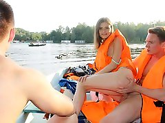 Cute broad enjoys MaleMaleFemale 3some fuck in the boat
