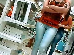 Chicks in tight jeans pants at supermarket