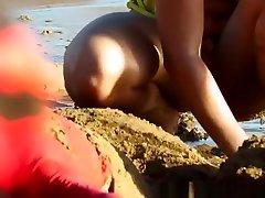 Hot girl in yellow bikini at the beach