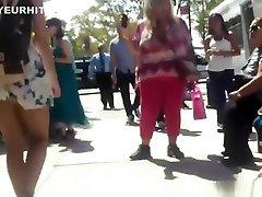 Teen in short dress upskirted in street