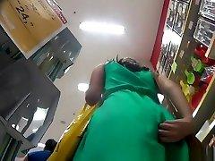 Chick in green short dress upskirted