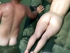 Naked ginger girl floats in the water
