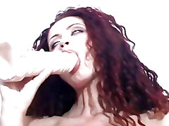 Sexy bi strong mf wm Danny Delano amuses herself with a big toy in her hot moist lips