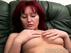 Busty redhead MILF masturbates while awaits for a dick