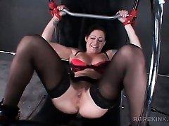 Stockinged sex slave gets labias clipped